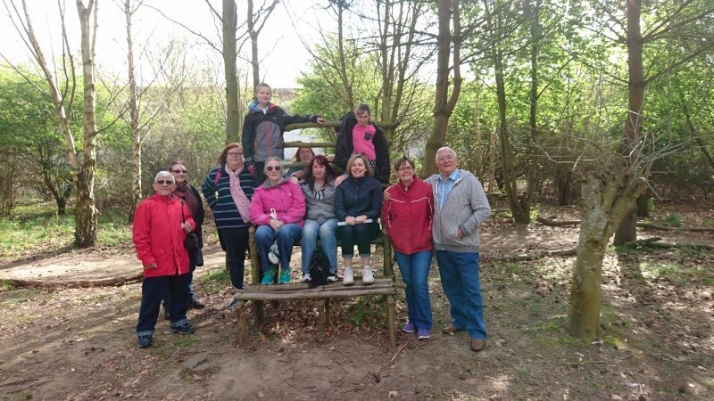 A group of carers stood together for a photo in woodlands, during a Carers Walk and Talk in Gorleston.